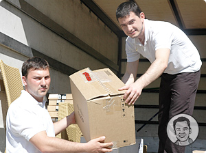 Our Removalists in Melbourne Unloading Boxes from the Removals Truck